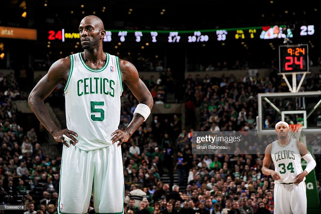 Kevin Garnett #5 and Paul Pierce #34 of the Boston Celtics wait to resume action against the New York Knicks on January 24, 2013 at the TD Garden in Boston, Massachusetts.