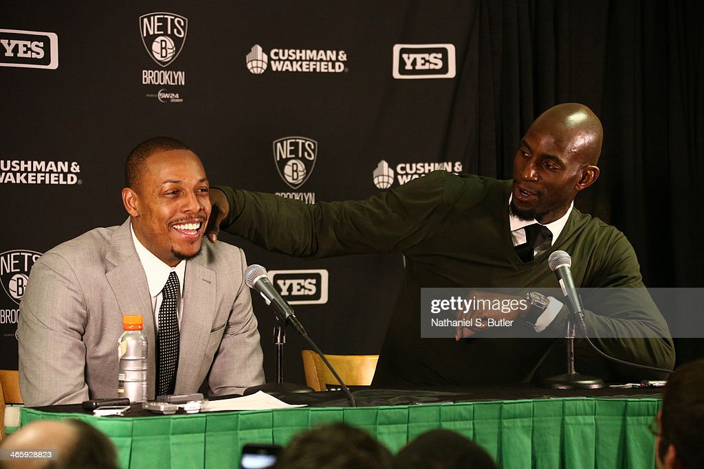 Kevin Garnett #2 and Paul Pierce #34 of the Brooklyn Nets answers questions after the game against the Boston Celtics during a game at TD Garden in Boston.