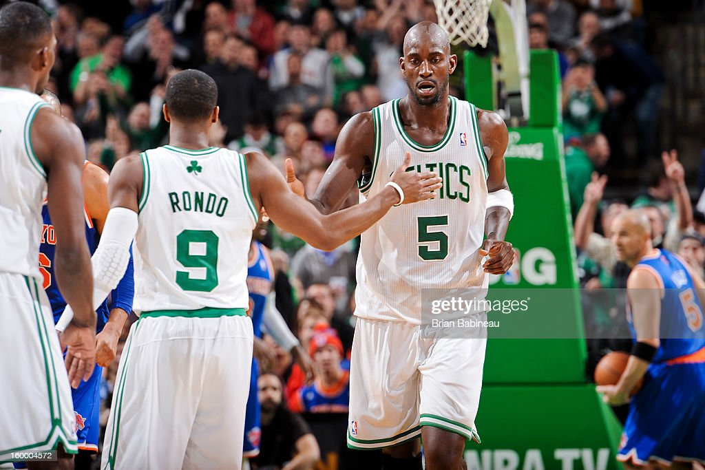 Kevin Garnett #5 and Rajon Rondo #9 of the Boston Celtics celebrate during a game against the New York Knicks on January 24, 2013 at the TD Garden in Boston, Massachusetts.