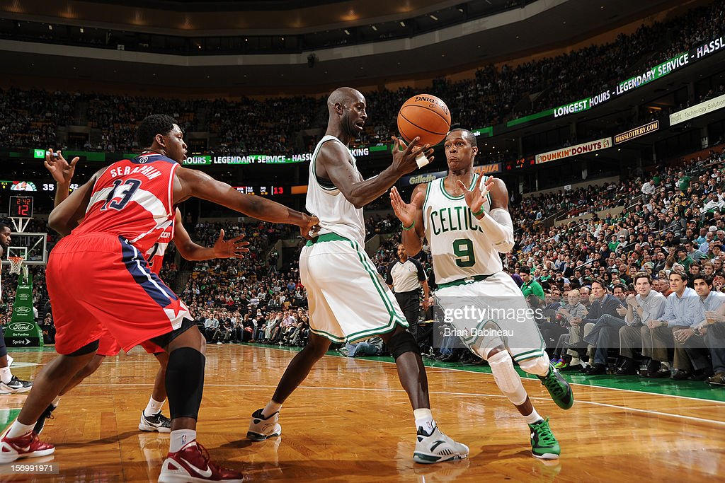 Kevin Garnett #5 and Rajon Rondo #9 of the Boston Celtics pass the ball against Kevin Seraphin #13 of the Washington Wizards on November 7, 2012 at the TD Garden in Boston, Massachusetts.