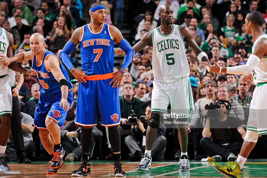 Kevin Garnett #5 and Rajon Rondo #9 of the Boston Celtics wait to resume action against Carmelo Anthony #7 and Jason Kidd #5 of the New York Knicks on January 24, 2013 at the TD Garden in Boston, Massachusetts.