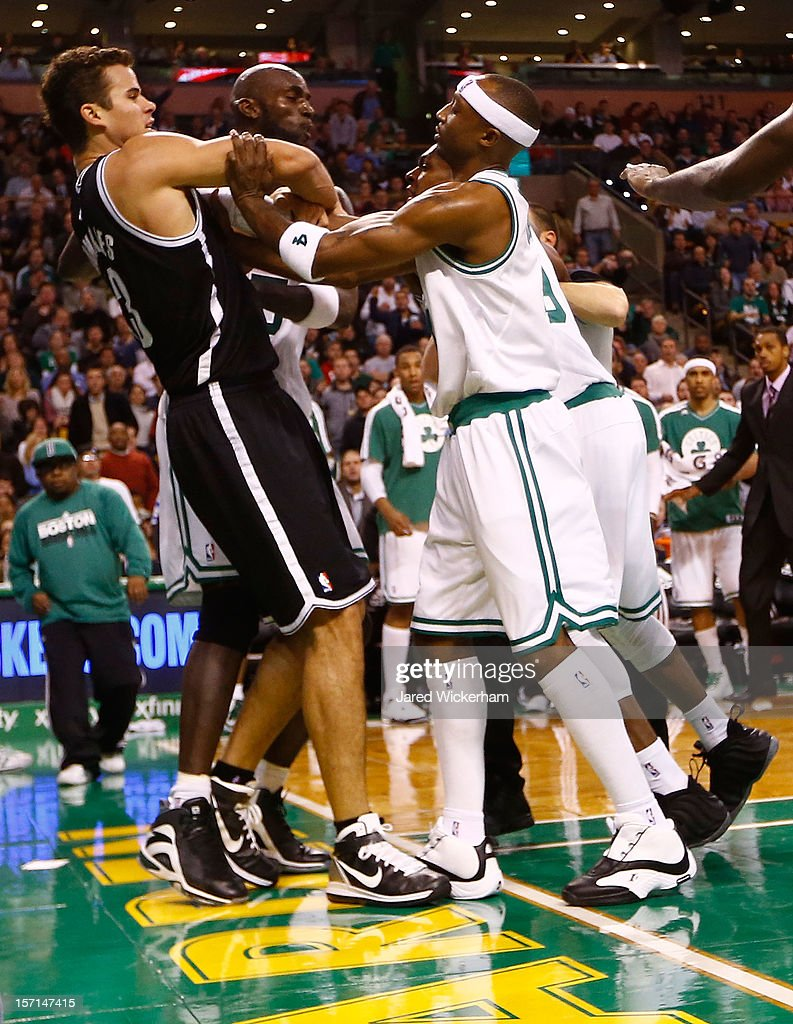 Kevin Garnett #5, Jason Terry #4, and Rajon Rondo #9 of the Boston Celtics get into a fight with Kris Humphries #43 of the Brooklyn Nets during the game after Garnett was fouled on a play on November 28, 2012 at TD Garden in Boston, Massachusetts. Rajon Rondo and Kris Humphries would each be ejected from the game immediately following the fight.