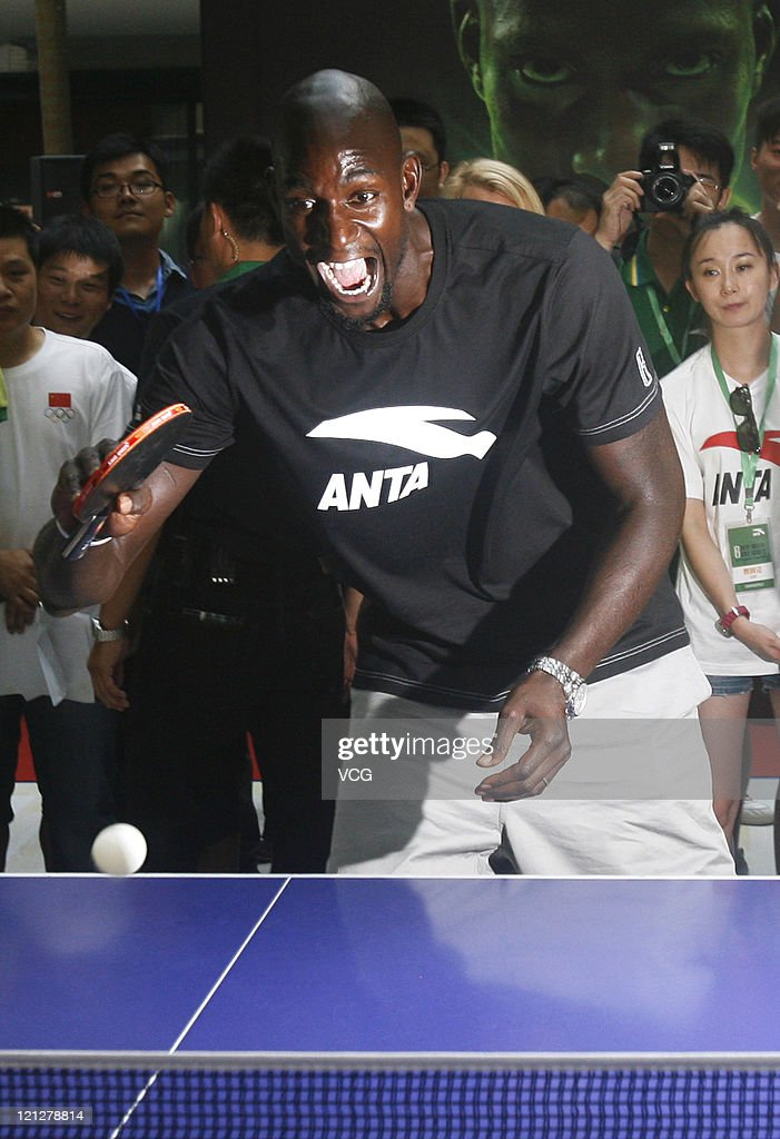 <a gi-track='captionPersonalityLinkClicked' href=/galleries/search?phrase=Kevin+Garnett&family=editorial&specificpeople=201473 ng-click='$event.stopPropagation()'>Kevin Garnett</a> of Boston Celtics plays table tennis during ANTA commercial event on August 17, 2011 in Wuhan, Hubei Province of China.