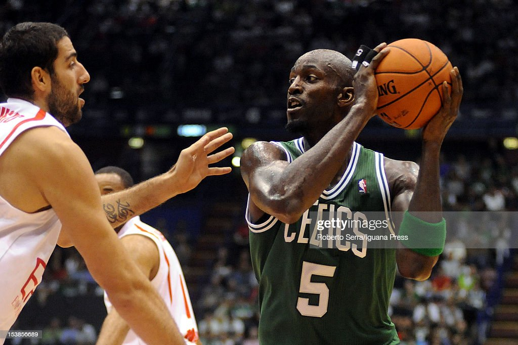 Kevin Garnett # 5 of Celtics competes with Ioannis Bourousis # 15 of Armani during the NBA Europe Live game between EA7 Emporio Armani Milano v Boston Celtics at Mediolanum Forum on October 7, 2012 in Milan, Italy.