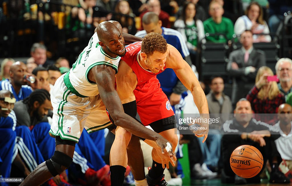 Kevin Garnett #5 of the Boston Celtics and Blake Griffin #32 of the Los Angeles Clippers reach for the ball on February 3, 2013 at the TD Garden in Boston, Massachusetts.
