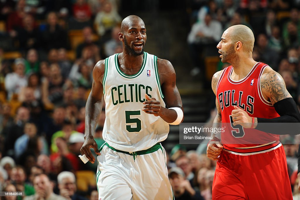 Kevin Garnett #5 of the Boston Celtics and Carlos Boozer #5 of the Chicago Bulls run up-court during the game on February 13, 2013 at the TD Garden in Boston, Massachusetts.