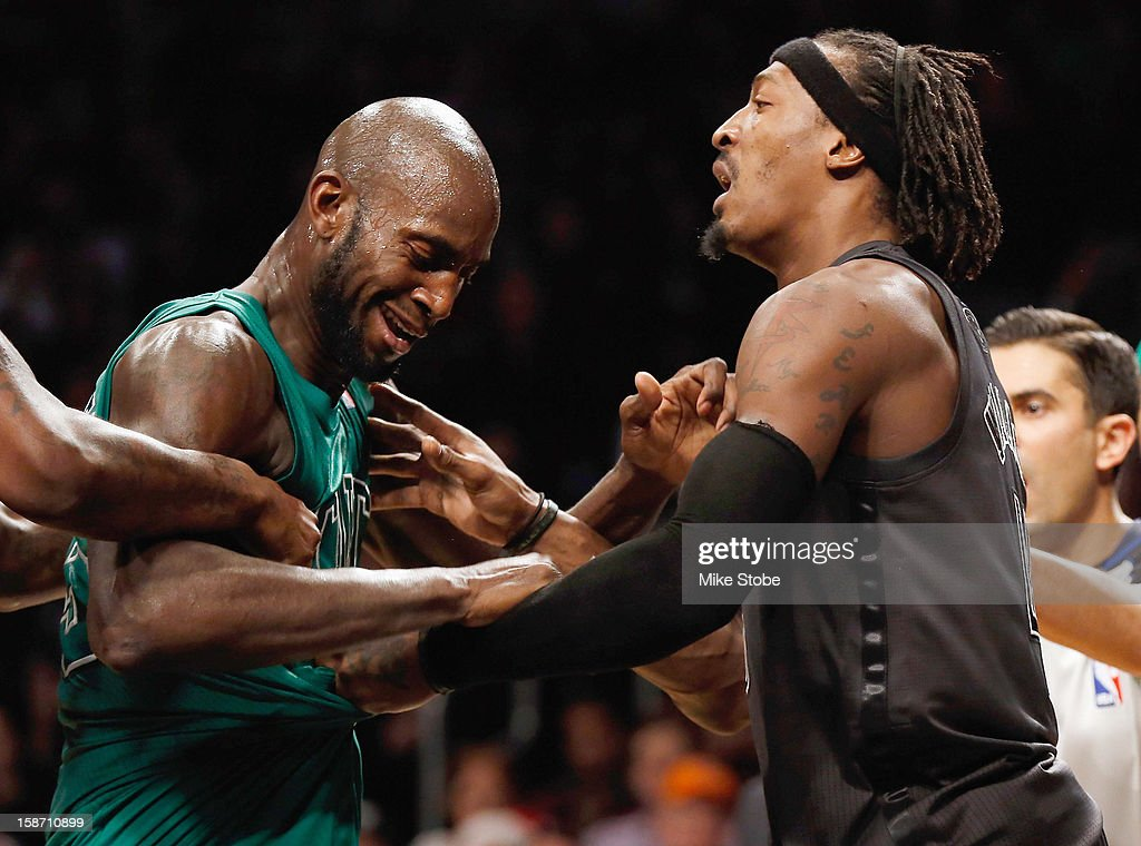 Kevin Garnett #5 of the Boston Celtics and Gerald Wallace #45 of the Brooklyn Nets get tangled up and exchange words at the Barclays Center on December 25, 2012 in the Brooklyn borough of New York City.