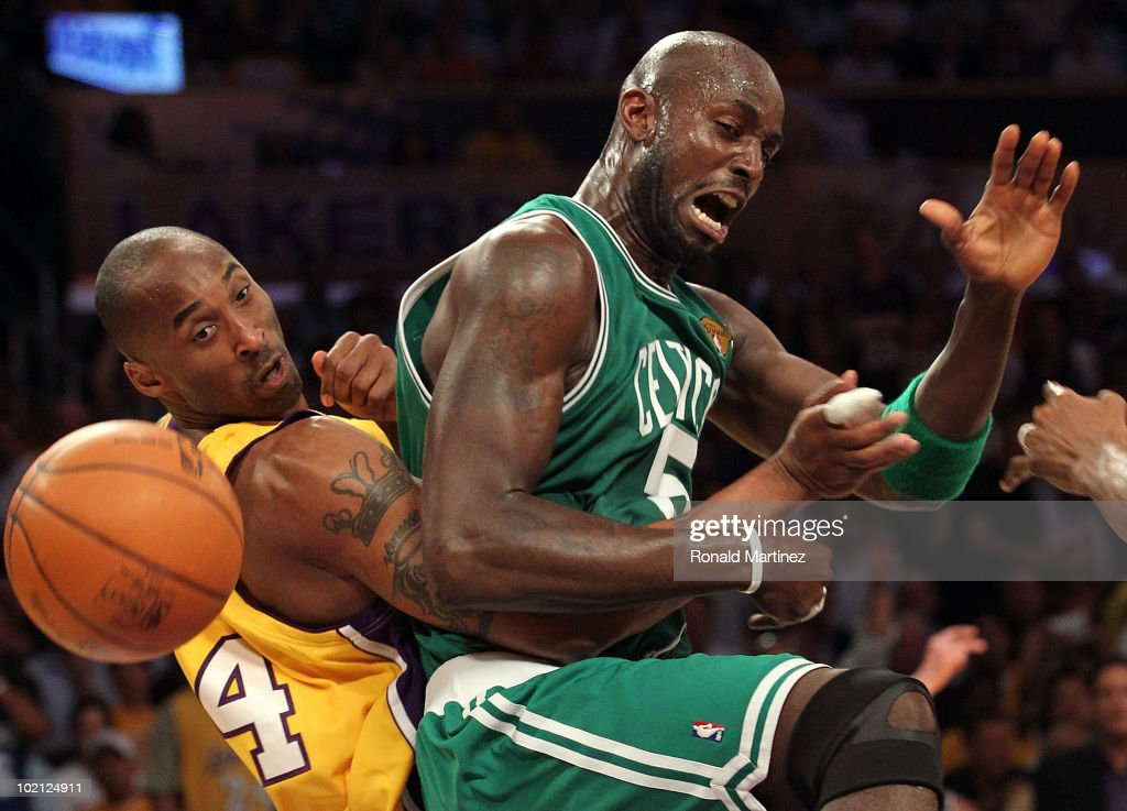 Kevin Garnett of the Boston Celtics and Kobe Bryant of the Los Angeles Lakers battle for the ball in the first period of Game Six of the 2010 NBA...