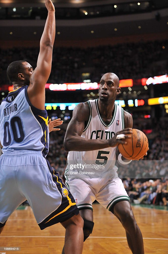 Kevin Garnett #5 of the Boston Celtics attempts to go strong to the basket against the Memphis Grizzlies on January 2, 2013 at the TD Garden in Boston, Massachusetts.
