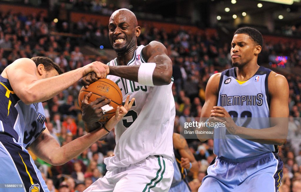 Kevin Garnett #5 of the Boston Celtics attempts to grab the ball away from Marc Gasol #33 of the Memphis Grizzlies on January 2, 2013 at the TD Garden in Boston, Massachusetts.