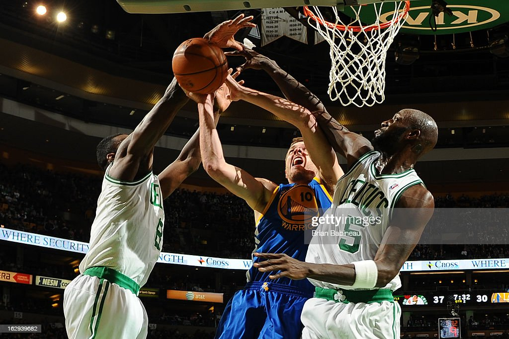Kevin Garnett #5 of the Boston Celtics blocks a shot against David Lee #10 of the Golden State Warriors on March 1, 2013 at the TD Garden in Boston, Massachusetts.