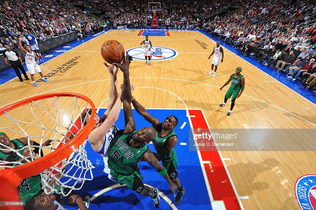 Kevin Garnett #5 of the Boston Celtics blocks a shot against Spencer Hawes #00 of the Philadelphia 76ers at the Wells Fargo Center on December 7, 2012 in Philadelphia, Pennsylvania.