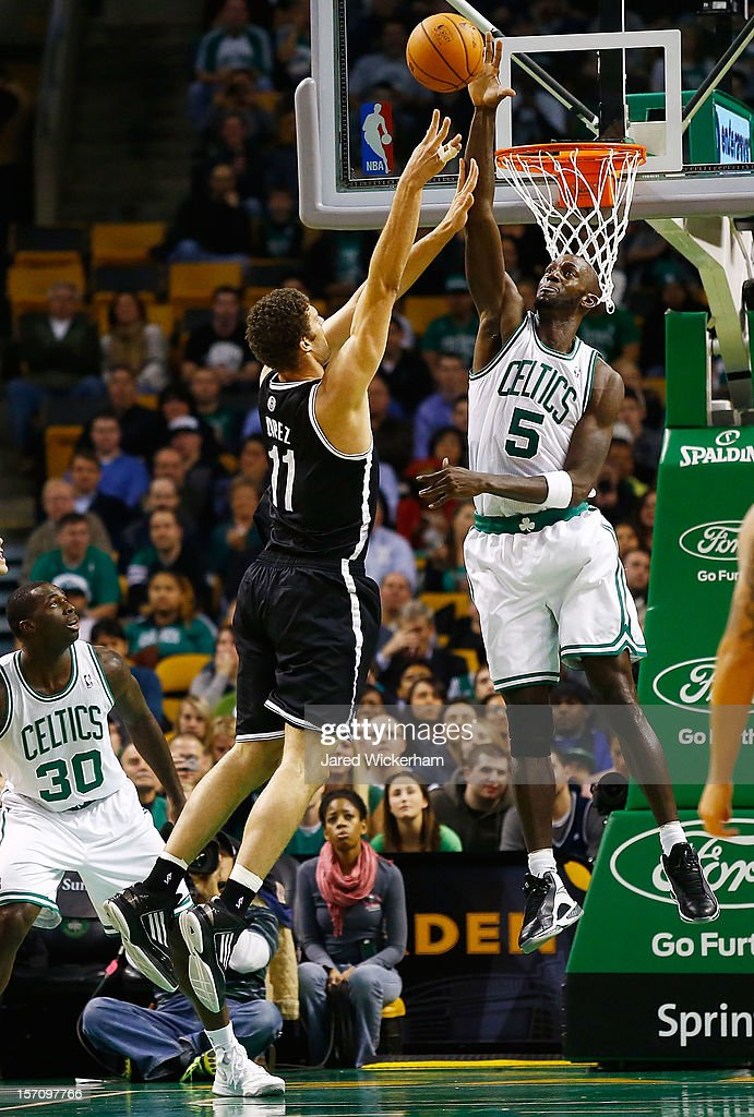 Kevin Garnett #5 of the Boston Celtics blocks a shot by Brook Lopez #11 of the Brooklyn Nets during the game on November 28, 2012 at TD Garden in Boston, Massachusetts.