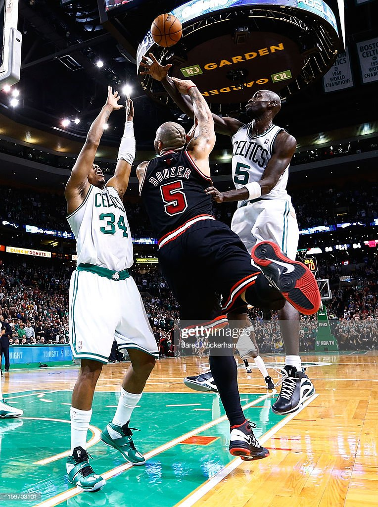 Kevin Garnett #5 of the Boston Celtics blocks a shot by Carlos Boozer #5 of the Chicago Bulls during the game on January 18, 2013 at TD Garden in Boston, Massachusetts.