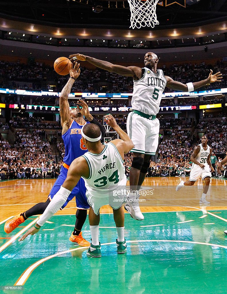 Kevin Garnett #5 of the Boston Celtics blocks a shot by J.R. Smith #8 of the New York Knicks during Game Three of the Eastern Conference Quarterfinals of the 2013 NBA Playoffs on April 26, 2013 at TD Garden in Boston, Massachusetts.