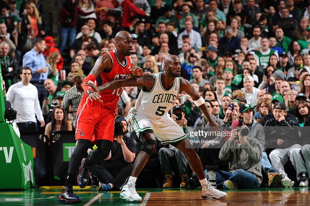 Kevin Garnett #5 of the Boston Celtics calls for the ball while guarded by Johan Petro #10 of the Atlanta Hawks on March 8, 2013 at the TD Garden in Boston, Massachusetts.