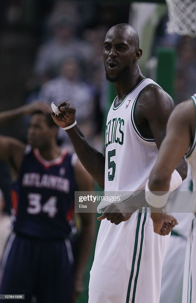 Kevin Garnett #5 of the Boston Celtics celebrates a basket as Jason Collins #34 of the Atlanta Hawks reacts in the second half on December 16, 2010 at the TD Garden in Boston, Massachusetts. The Celtics defeated the Hawks 102-90.