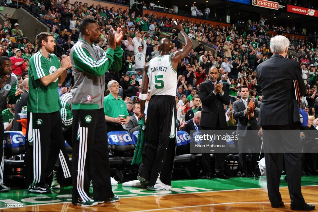 <a gi-track='captionPersonalityLinkClicked' href=/galleries/search?phrase=Kevin+Garnett&family=editorial&specificpeople=201473 ng-click='$event.stopPropagation()'>Kevin Garnett</a> #5 of the Boston Celtics celebrates passing <a gi-track='captionPersonalityLinkClicked' href=/galleries/search?phrase=Wes+Unseld&family=editorial&specificpeople=212864 ng-click='$event.stopPropagation()'>Wes Unseld</a> for the 10th all-time on the NBA rebounding list during the game against the Atlanta Hawks on March 8, 2013 at the TD Garden in Boston, Massachusetts.