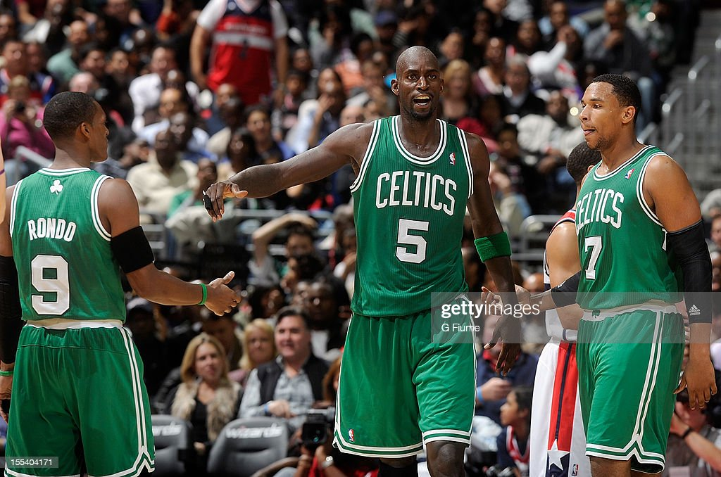 Kevin Garnett #5 of the Boston Celtics celebrates with Rajon Rondo #9 and Jared Sullinger #7 after scoring in the fourth quarter against the Washington Wizards at Verizon Center on November 3, 2012 in Washington, DC. Boston won the game 89-86.