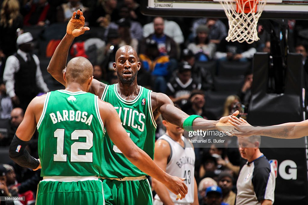 Kevin Garnett #5 of the Boston Celtics celebrates with teammate Leandro Barbosa #12 while playing the Brooklyn Nets on November 15, 2012 at the Barclays Center in the Brooklyn borough of New York City.