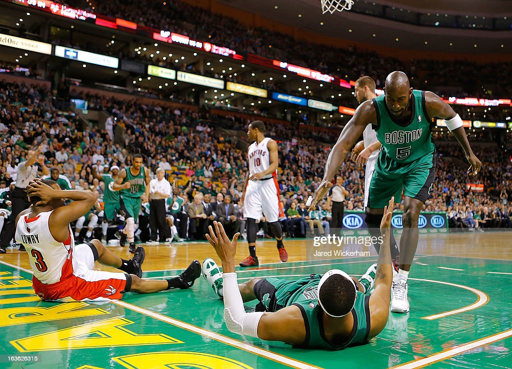 Kevin Garnett #5 of the Boston Celtics celebrates with teammate Paul Pierce #34 of the Boston Celtics after making a shot and being fouled by Kyle Lowry #3 of the Toronto Raptors during the game on March 13, 2013 at TD Garden in Boston, Massachusetts.