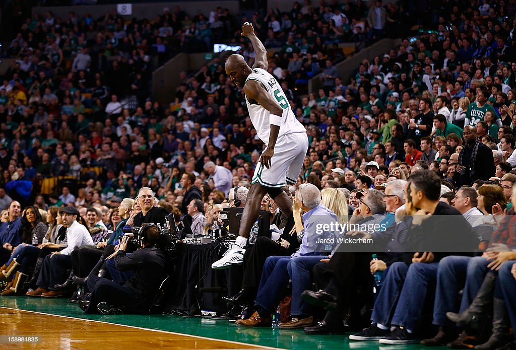 Kevin Garnett #5 of the Boston Celtics climbs over a table to reenter the game after leaping into the seats courtside seats attempting to grab a loose ball against the Indiana Pacers during the game on January 4, 2013 at TD Garden in Boston, Massachusetts.