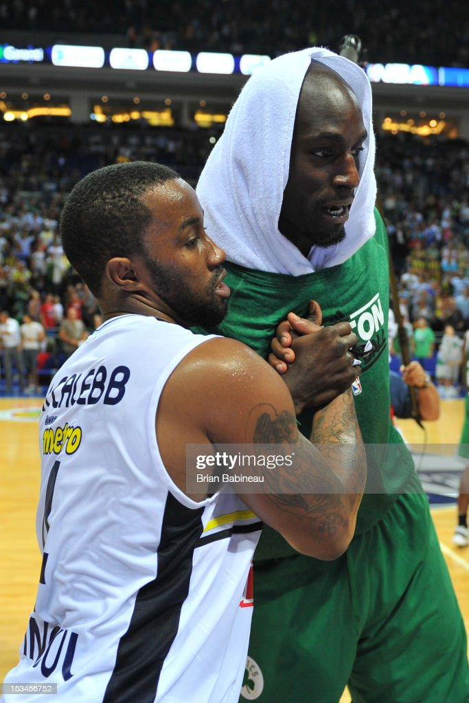 Kevin Garnett #5 of the Boston Celtics congratulates Bo McCalebb #4 of Fenerbahce Ulker on October 5, 2012 at the Ulker Sports Arena in Istanbul, Turkey.