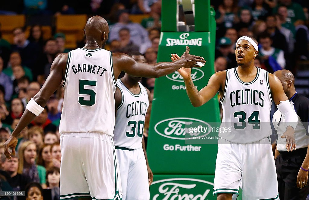 Kevin Garnett #5 of the Boston Celtics congratulates teammate Paul Pierce #34 of the Boston Celtics during the game against the Sacramento Kings on January 30, 2013 at TD Garden in Boston, Massachusetts.