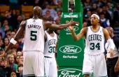 Kevin Garnett of the Boston Celtics congratulates teammate Paul Pierce of the Boston Celtics during the game against the Sacramento Kings on January...