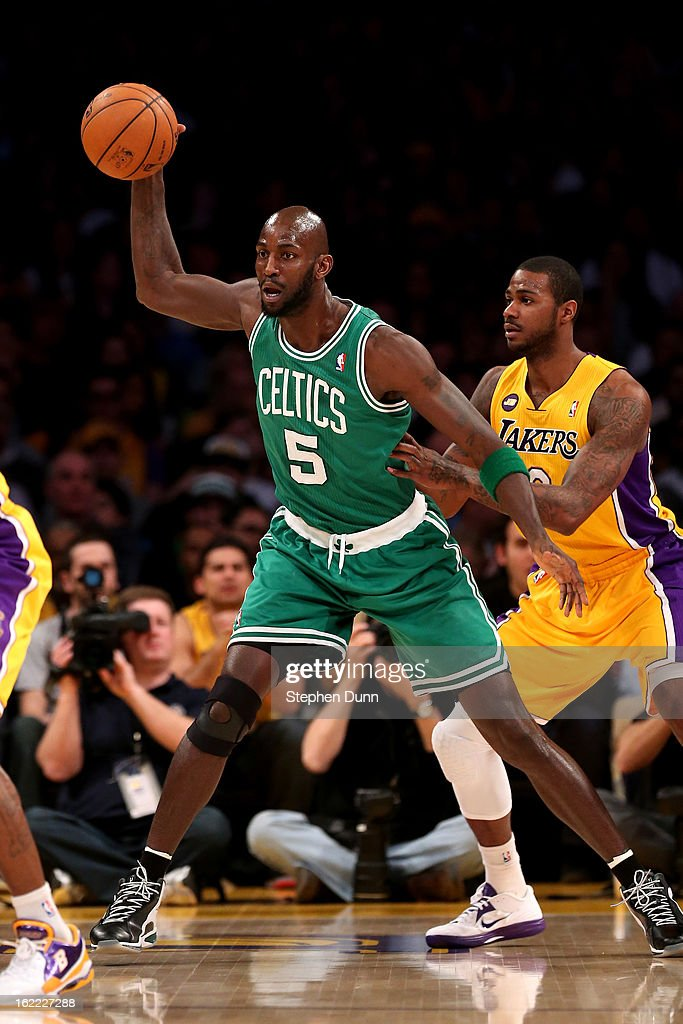 Kevin Garnett #5 of the Boston Celtics controls the ball against Earl Clark #6 of the Los Angeles Lakers at Staples Center on February 20, 2013 in Los Angeles, California.