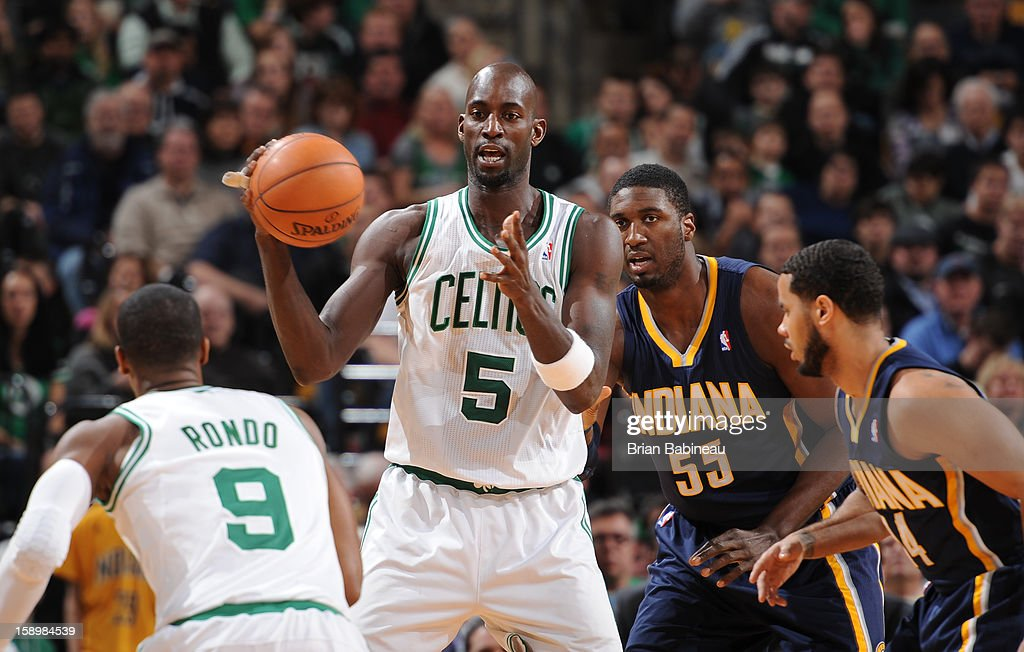 Kevin Garnett #5 of the Boston Celtics controls the ball against Roy Hibbert #55 and D.J. Augustin #14 of the Indiana Pacers on January 4, 2013 at the TD Garden in Boston, Massachusetts.