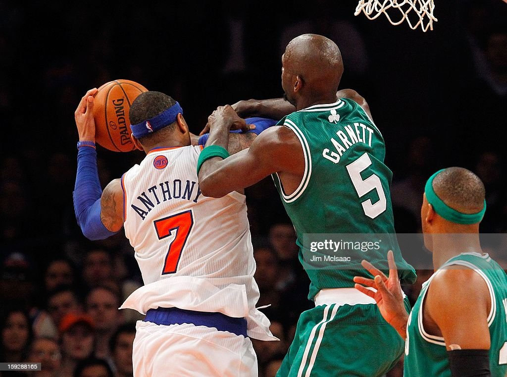 Kevin Garnett #5 of the Boston Celtics defends against Carmelo Anthony #7 of the New York Knicks at Madison Square Garden on January 7, 2013 in New York City. The Celtics defeated the Knicks 102-96.