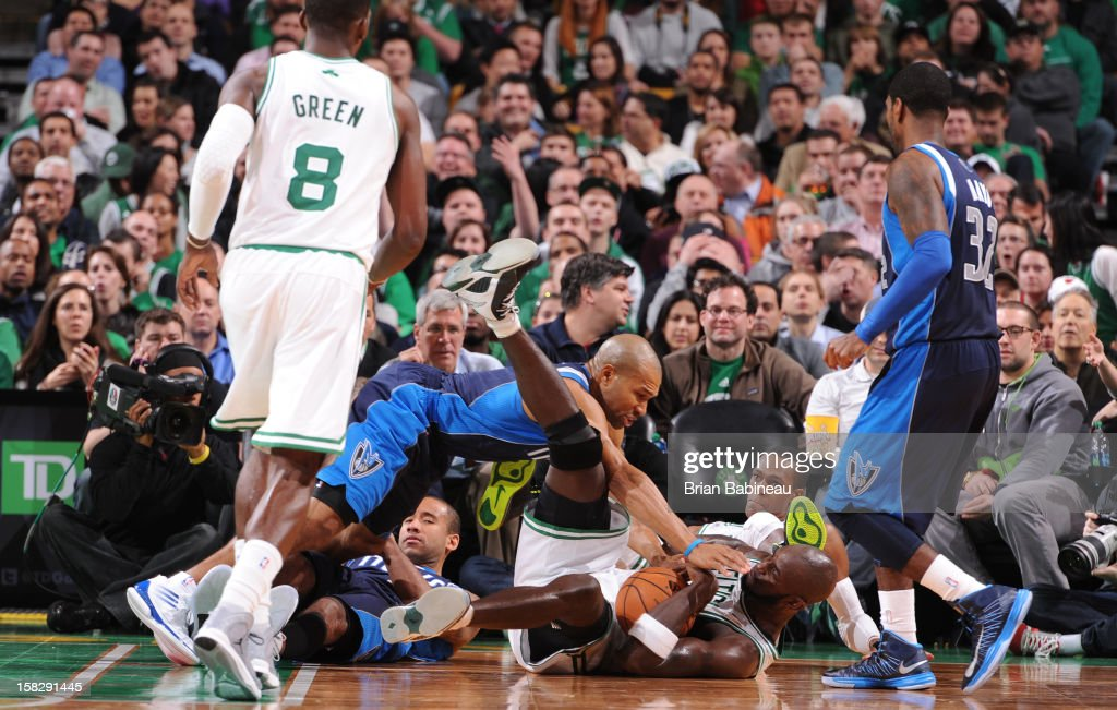 Kevin Garnett #5 of the Boston Celtics dives for a loose ball against Derek Fisher #6 of the Dallas Mavericks during the game between the Boston Celtics and the Dallas Mavericks on December 12, 2012 at the TD Garden in Boston, Massachusetts.