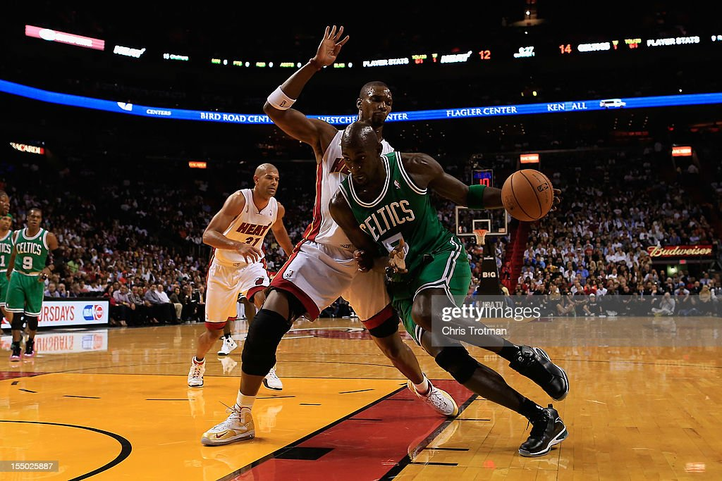 Kevin Garnett #5 of the Boston Celtics drives against Chris Bosh #1 of the Miami Heat at American Airlines Arena on October 30, 2012 in Miami, Florida.
