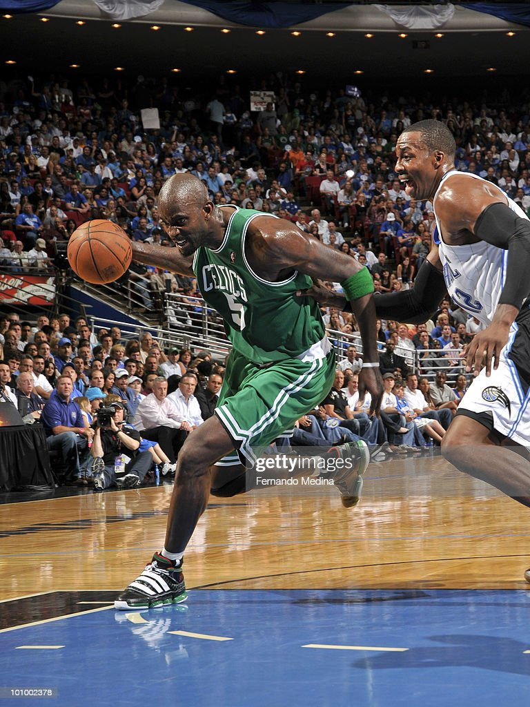 Kevin Garnett #5 of the Boston Celtics drives against Dwight Howard #12 of the Orlando Magic in Game Five of the Eastern Conference Finals during the 2010 NBA Playoffs on May 26, 2010 at Amway Arena in Orlando, Florida.