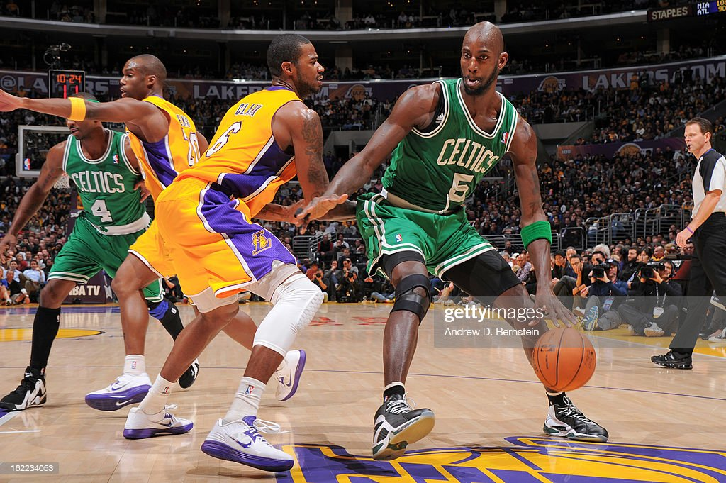 Kevin Garnett #5 of the Boston Celtics drives against Earl Clark #6 of the Los Angeles Lakers during a game at Staples Center on February 20, 2013 in Los Angeles, California.