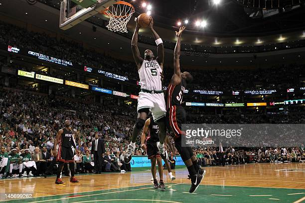 Kevin Garnett of the Boston Celtics drives for a shot attempt against Joel Anthony of the Miami Heat in Game Four of the Eastern Conference Finals in...