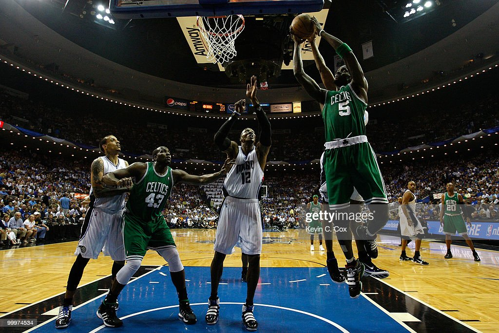 Kevin Garnett #5 of the Boston Celtics drives for a shot attempt against Dwight Howard #12 of the Orlando Magic in Game Two of the Eastern Conference Finals during the 2010 NBA Playoffs at Amway Arena on May 18, 2010 in Orlando, Florida.