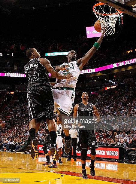 Kevin Garnett of the Boston Celtics drives on Mario Chalmers of the Miami Heat during a game at American Airlines Arena on April 10 2012 in Miami...