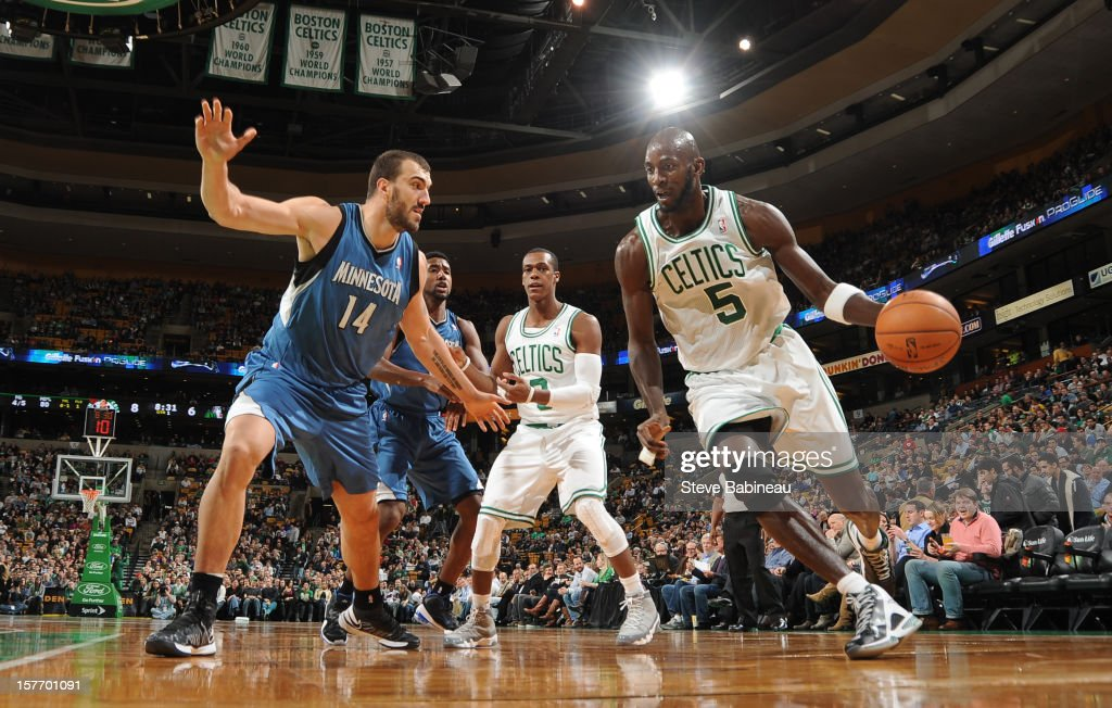 Kevin Garnett #5 of the Boston Celtics drives to the basket against Nikola Pekovic #14 of the Minnesota Timberwolves on December 5, 2012 at the TD Garden in Boston, Massachusetts.