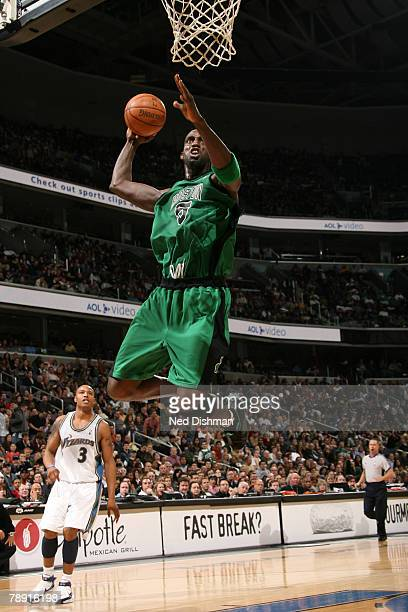 Kevin Garnett of the Boston Celtics dunks against Caron Butler of the Washington Wizards at the Verizon Center January 12 2008 in Washington DC NOTE...