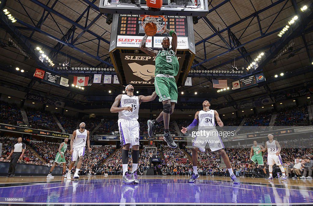 Kevin Garnett #5 of the Boston Celtics dunks against DeMarcus Cousins #15 and Jason Thompson #34 of the Sacramento Kings on December 30, 2012 at Sleep Train Arena in Sacramento, California.