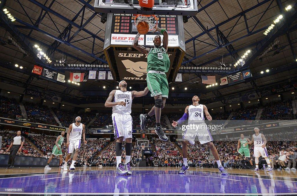 Kevin Garnett #5 of the Boston Celtics dunks against DeMarcus Cousins #15 and Jason Thompson #34 of the Sacramento Kings on December 30, 2012 at Sleep Train Arena in Sacramento, California.