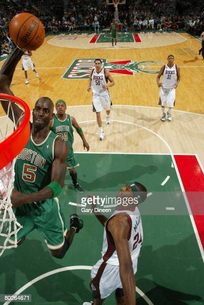 Kevin Garnett of the Boston Celtics dunks against Desmond Mason of the Milwaukee Bucks on March 15 2008 at the Bradley Center in Milwaukee Wisconsin...