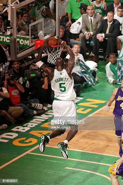 Kevin Garnett of the Boston Celtics dunks against Luke Walton of the Los Angeles Lakers during Game Six of the 2008 NBA Finals June 17 2008 at the TD...