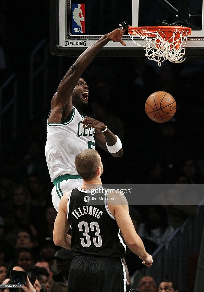 Kevin Garnett #5 of the Boston Celtics dunks against Mirza Teletovic #33 of the Brooklyn Nets during a preseason game at the Barclays Center on October 18, 2012 in the Brooklyn borough of New York City. The Celtics defeated the Nets 115-85.