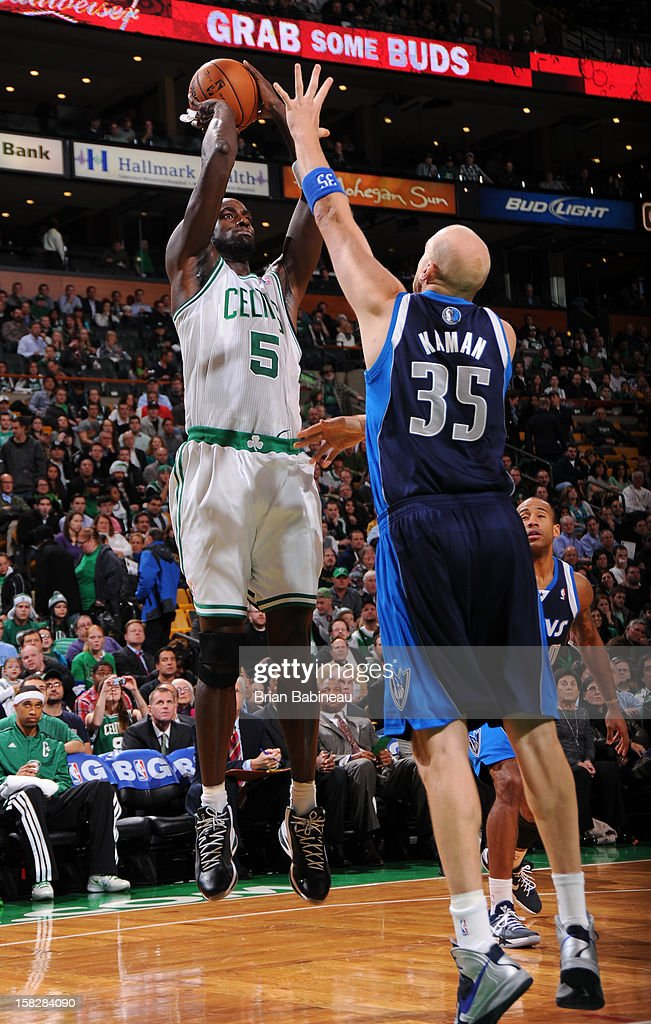 Kevin Garnett #5 of the Boston Celtics goes for a jump shot against Chris Kaman #35 of the Dallas Mavericks during the game between the Boston Celtics and the Dallas Mavericks on December 12, 2012 at the TD Garden in Boston, Massachusetts.