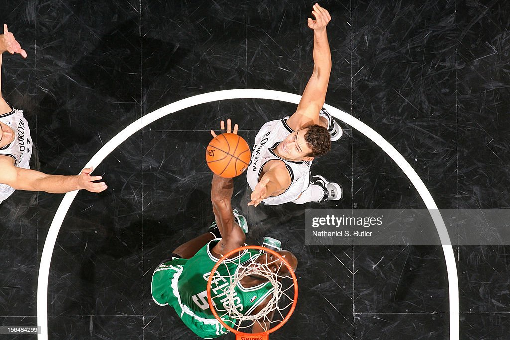 Kevin Garnett #5 of the Boston Celtics goes for a rebound against Kris Humphries #43 of the Brooklyn Nets on November 15, 2012 at the Barclays Center in the Brooklyn Borough of New York City.