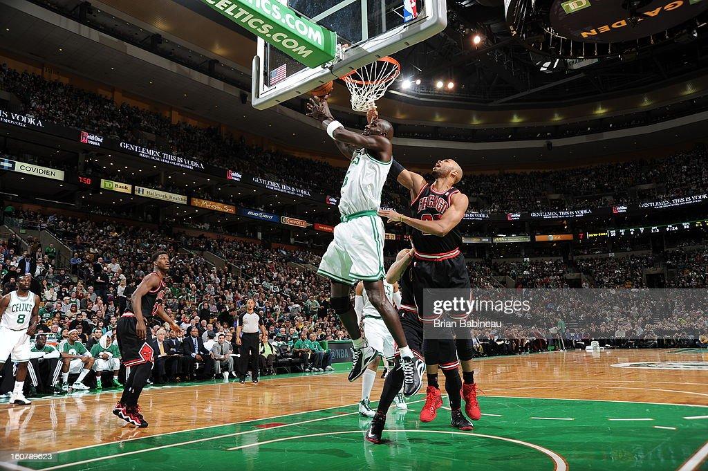 Kevin Garnett #5 of the Boston Celtics goes in for the layup against Taj Gibson #22 of the Chicago Bulls on January 18, 2013 at the TD Garden in Boston, Massachusetts.