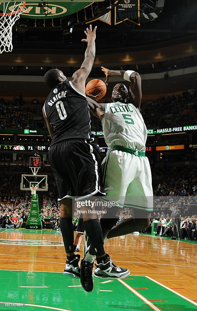 Kevin Garnett #5 of the Boston Celtics goes in for the shot against Andray Blatche #0 of the Brooklyn Nets on November 28, 2012 at the TD Garden in Boston, Massachusetts.